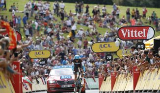 France's Romain Bardet climbs in the last meters of the twentieth stage of the Tour de France cycling race, an individual time trial over 31 kilometers (19.3 miles)with start in Saint-Pee-sur-Nivelle and finish in Espelette, France, Saturday July 28, 2018. (AP Photo/Christophe Ena )