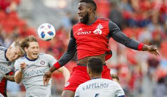 Toronto FC's Jozy Altidore leaps for the ball between Chicago Fire players, including Johan Kappelhof (4), during the first half of an MLS soccer match Saturday, July 28, 2018, in Toronto. (Mark Blinch/The Canadian Press via AP)