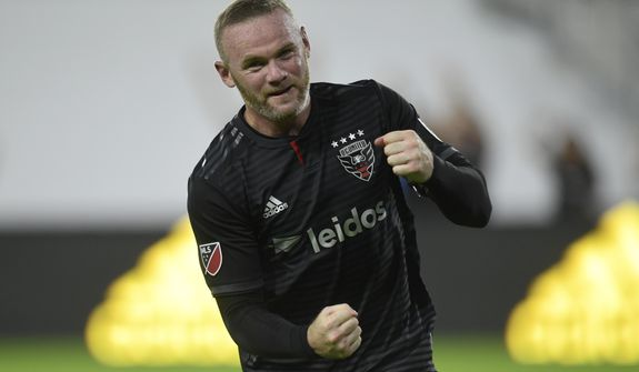 D.C. United forward Wayne Rooney celebrates his first MLS goal during the first half of a soccer match against the Colorado Rapids in Washington, Saturday, July 28, 2018. (AP Photo/Susan Walsh) **FILE**