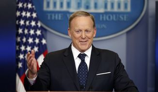 In this Tuesday, June 20, 2017, file photo, then-White House press secretary Sean Spicer smiles as he answers a question during a briefing at the White House, in Washington. (AP Photo/Alex Brandon, File)