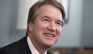 "In this July 18, 2018, file photo, Supreme Court nominee Judge Brett Kavanaugh smiles during a meeting with Sen. Mike Lee, R-Utah, on Capitol Hill in Washington. Kavanaugh says he recognizes that gun, drug and gang violence ""has plagued all of us."" Still, he believes the Constitution limits how far government can go to restrict gun use to prevent violent crime (AP Photo/J. Scott Applewhite, File)"