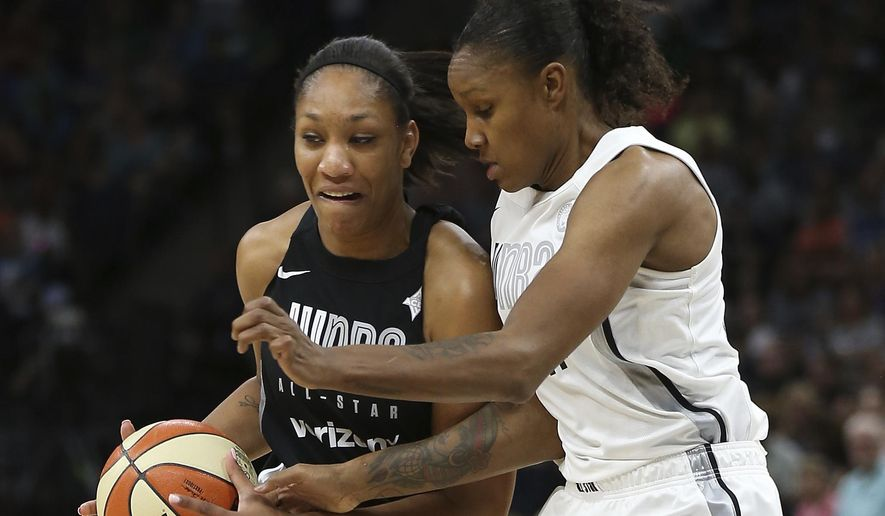 Team Delle Donne's A'ja Wilson, left, controls the ball against Team Candace Parker's Rebekkah Brunson, right, in the first half of the WNBA All-Star basketball game Saturday, July 28, 2018 in Minneapolis. Candace Parker's team won 119-112. (AP Photo/Stacy Bengs) **FILE**