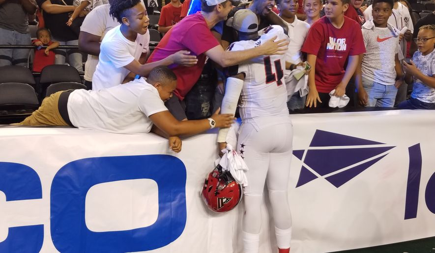 Fans of the Arena Football League team Washington Valor celebrate with Valor quarterback Arvell Nelson (No. 4) after the team won ArenaBowl XXXI over the Baltimore Brigade on Saturday, July 28, 2018 at Royal Farms Arena in Baltimore. (Photo by Adam Zielonka / The Washington Times)