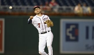 Washington Nationals shortstop Trea Turner (7) throws to first during a baseball game against the Atlanta Braves, Sunday, July 22, 2018, in Washington. The Nationals won 6-2.(AP Photo/Nick Wass) ** FILE **