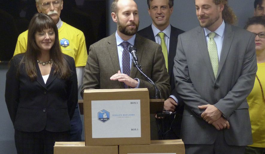 Josh Hovey, spokesman for the Coalition to Regulate Marijuana Like Alcohol, speaks at a news conference in Lansing, Mich., where group submitted more than 360,000 signatures for a 2018 ballot drive to legalize the use of marijuana for recreational purposes. A proposal to legalize marijuana has sprouted on Michigan's November ballot, putting the state on the cusp of allowing recreational use of the drug for those 21 and older. It could also entice younger voters to show up to the polls, which could help the Democrats. (AP Photo/David Eggert, File)