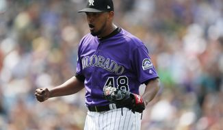Colorado Rockies starting pitcher German Marquez reacts after Oakland Athletics' Marcus Semien grounded into a double play to end the top of the seventh inning of a baseball game Sunday, July 29, 2018, in Denver. (AP Photo/David Zalubowski)