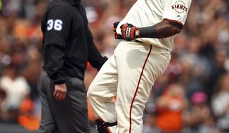 San Francisco Giants' Pablo Sandoval celebrates after hitting a two run triple against the Milwaukee Brewers in the fifth inning of a baseball game Sunday, July 29, 2018, in San Francisco. (AP Photo/Ben Margot)