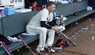 Atlanta Braves starting pitcher Sean Newcomb sits on the bench after losing his bid for a no-hitter in the ninth inning of a baseball game against the Los Angeles Dodgers, Sunday, July 29, 2018, in Atlanta. (AP Photo/John Bazemore)