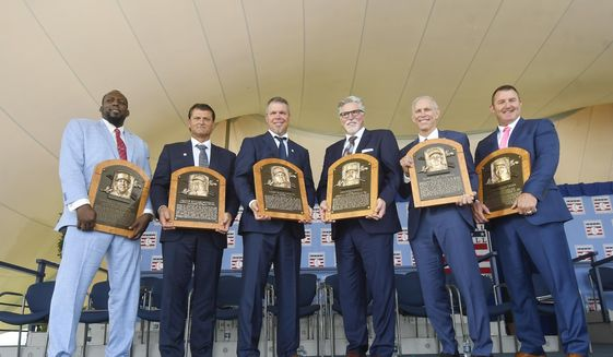 Baseball Hall of Famers from left, Vladimir Guerrero, Trevor Hoffman, Chipper Jones, Jack Morris, Alan Trammell, and Jim Thome, hold their plaques after an induction ceremony at the Clark Sports Center on Sunday, July 29, 2018, in Cooperstown, N.Y. (AP Photo/Hans Pennink)