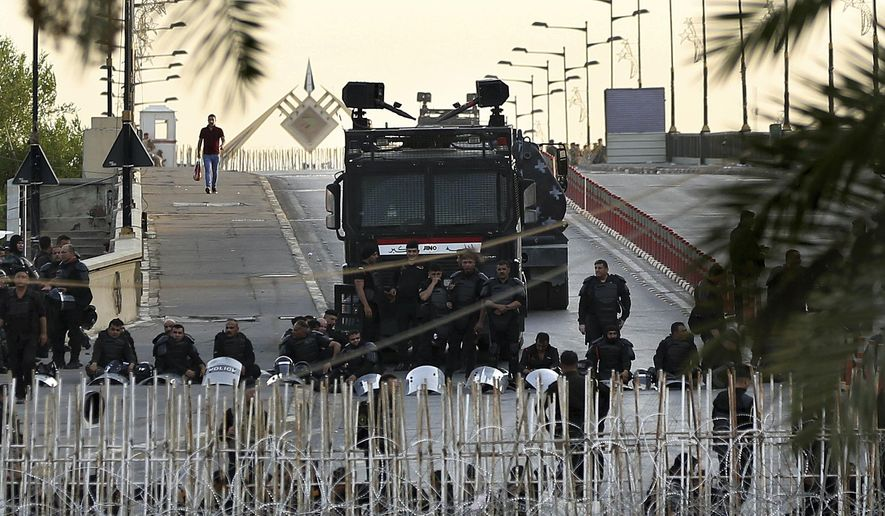 Iraqi riot police close a bridge leading to the heavily guarded Green Zone during protests demanding services and jobs in central Baghdad, Iraq, Friday, July 27, 2018. (AP Photo/Hadi Mizban)