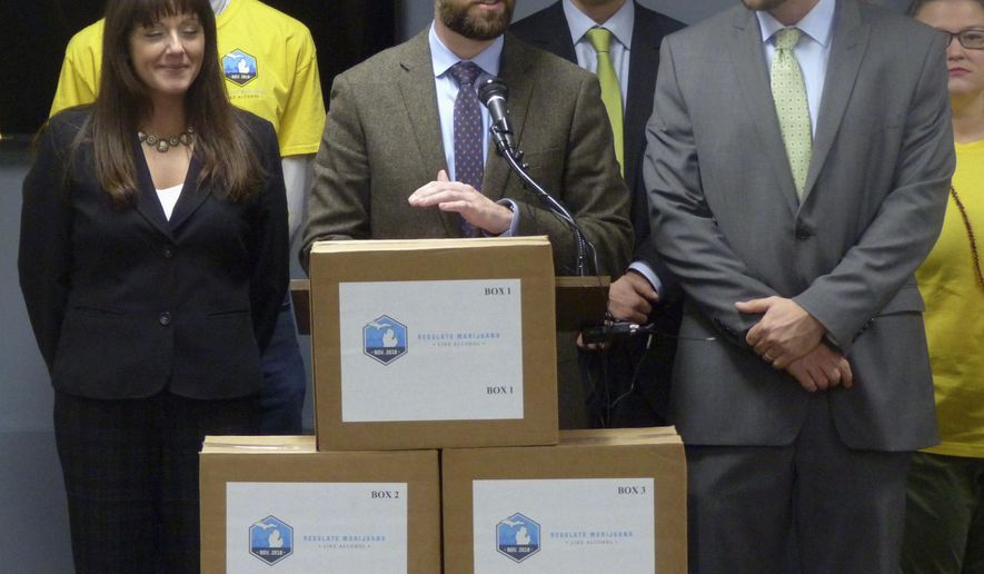 FILE - In this Nov. 20, 2017, file photo, Josh Hovey, spokesman for the Coalition to Regulate Marijuana Like Alcohol, speaks at a news conference in Lansing, Mich., where group submitted more than 360,000 signatures for a 2018 ballot drive to legalize the use of marijuana for recreational purposes. A proposal to legalize marijuana has sprouted on Michigan's November ballot, putting the state on the cusp of allowing recreational use of the drug for those 21 and older. It could also entice younger voters to show up to the polls, which could help the Democrats. (AP Photo/David Eggert, File)