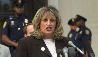 Linda Tripp, the Pentagon employee whose secret tape recordings of former White House intern Monica Lewinsky triggered a criminal investigation of President Clinton, talks to reporters outside federal court in Washington on July 29, 1998, after making her final appearance before the grand jury that's looking into allegations of a sexual relationship between Lewinsky and President Clinton. (Associated Press) **FILE**