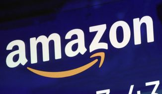The logo for Amazon is displayed on a screen at the Nasdaq MarketSite, Friday, July 27, 2018. (AP Photo/Richard Drew)