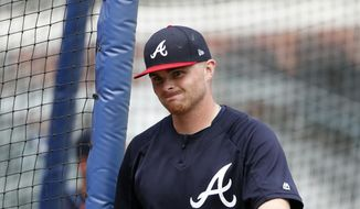 """Atlanta Braves starting pitcher Sean Newcomb (15) is shown during batting practice before of a baseball game against the Miami Marlins Monday, July 30, 2018 in Atlanta. Newcomb apologized Sunday for racist, homophobic and sexist tweets he sent as a teenager, calling them """"some stupid stuff.""""""""I definitely regret it, for sure,"""" he said. (AP Photo/John Bazemore)"""