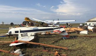 This Sunday, July 29, 2018, photo provided by Colorado Sen. Cory Gardner shows damage from a storm just after it hit the area near Brush, Colo. People on the plains of northeastern Colorado were cleaning up Monday from a powerful storm that swept through the state, ripping off roofs, flipping trucks and damaging crops. No serious injuries were reported. (Cory Gardner via AP)
