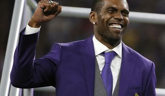 FILE - In this Sept. 11, 2017, file photo, former Minnesota Vikings wide receiver Randy Moss reacts as he is inducted into the Vikings Ring of Honor during halftime of an NFL football game between the Vikings and the New Orleans Saints, in Minneapolis. Randy Moss, elected to the Pro Football Hall of Fame in his first year of eligibility, ranks second in NFL history with 156 career touchdown receptions and fourth with 15,292 career receiving yards. (AP Photo/Bruce Kluckhohn, File)