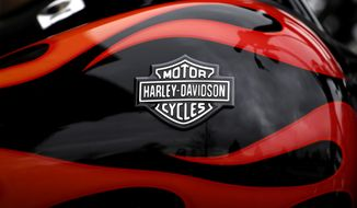 FILE - This April 27, 2017, file photo shows the Harley-Davidson name on the gas tank of a bike in Glenview, Ill. The iconic American motorcycle company, facing dwindling sales in its home market, said Monday, July 30, 2018, that it would be rolling out some new products, and stores, to broaden its audience and hopefully, invigorate sales. (AP Photo/Nam Y. Huh, File)