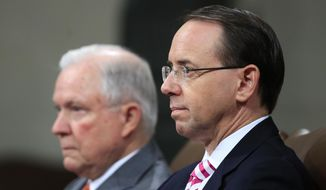 Attorney General Jeff Sessions, left, and Deputy Attorney General Rod Rosenstein, listen to remarks during a Religious Liberty Summit at the Department of Justice, Monday, July 30, 2018. (AP Photo/Manuel Balce Ceneta)