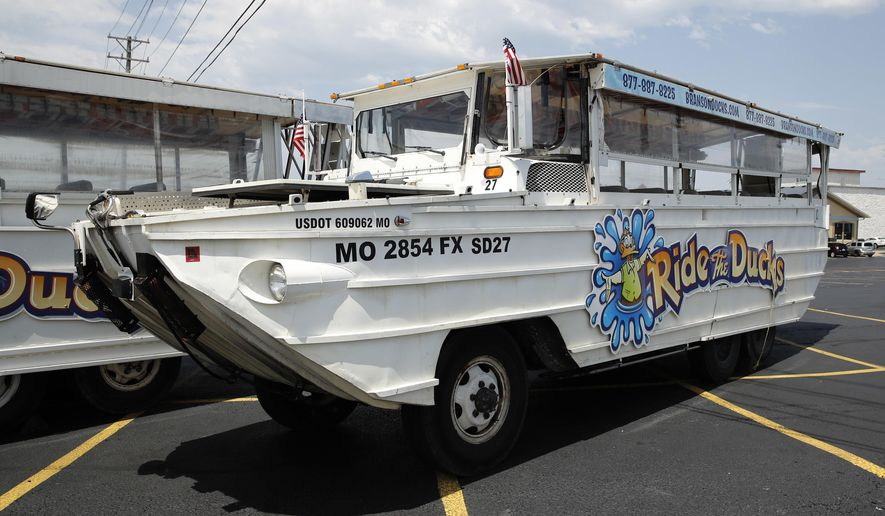 FILE - In this July 20, 2018, file photo, a duck boat sits idle in the parking lot of Ride the Ducks, an amphibious tour operator in Branson, Mo. A lawsuit seeking $100 million in damages was filed Sunday, July 29, against the owners and operators of a duck boat that sank July 19. (AP Photo/Charlie Riedel, File)
