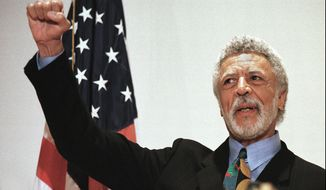 FILE - In this Nov. 17, 1997 file photo Democratic Rep. Ron Dellums raises his fist while announcing his retirement from Congress at a news conference in Oakland, Calif. Dellums, a fiery anti-war activist who championed social justice as Northern California's first black congressman, has died at age 82. Longtime adviser Dan Lindheim says Dellums died early Monday, July 30, 2018, at his home in Washington, D.C., of cancer. (AP Photo/Ben Margot,File)