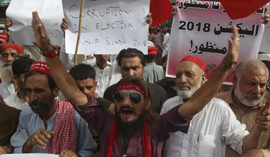 Supporters of Pakistan's National Awami Party voice their rejection of the election results in last week's polls, during a demonstration in Karachi, Pakistan, Sunday, July 30, 2018. (AP Photo/Shakil Adil)
