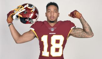 In this June 11, 2018, file photo, Washington Redskins wide receiver Josh Doctson poses during an NFL football photo session at the team training facility in Ashburn, Va. (AP Photo/Nick Wass, File)