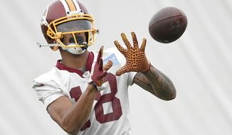FILE - In this June 13, 2018, file photo, Washington Redskins wide receiver Josh Doctson (18) makes a catch during NFL football practice in Ashburn, Va. An Achilles Tendon MRI for Washington Redskins receiver Josh Doctson seemed like reason for alarm. Instead, it was a chance to show the 2016 first-round pick is healthy again and able to make the next step to being a dynamic piece of the offense. (AP Photo/Nick Wass) ** FILE **