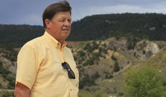 File - In this July 17, 2017, file photo, Land Commissioner Aubrey Dunn surveys the surrounding high desert vistas from an overlook at an old copper mine near Cuba, N.M. Libertarian Party U.S senatorial candidate Dunn is expected to announce that he is quitting the race, opening the door for former New Mexico Gov. Gary Johnson to jump in. Dunn is scheduled to unveil Monday, July 30, 2018, his reasons why he is leaving the race in New Mexico where he was to face Democratic incumbent Sen. Martin Heinrich and Republican Mick Rich in November. (AP Photo/Susan Montoya Bryan, File)