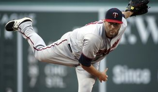 Minnesota Twins starting pitcher Lance Lynn delivers to a Boston Red Sox batter during the first inning of a baseball game at Fenway Park, Friday, July 27, 2018, in Boston. (AP Photo/Elise Amendola)