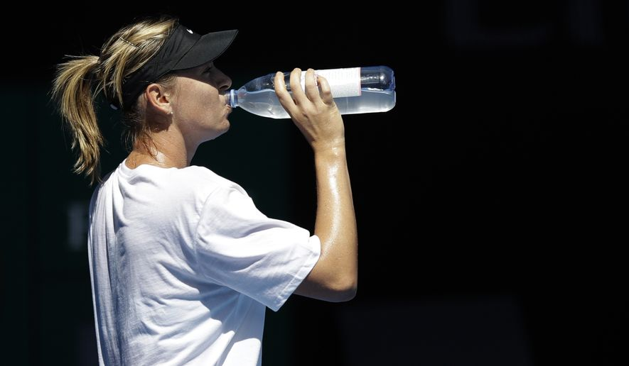 Russia's Maria Sharapova takes a drink of water during a practice session ahead of the Australian Open tennis championships in Melbourne, Australia, Sunday, Jan. 14, 2018. (AP Photo/Dita Alangkara) **FILE**