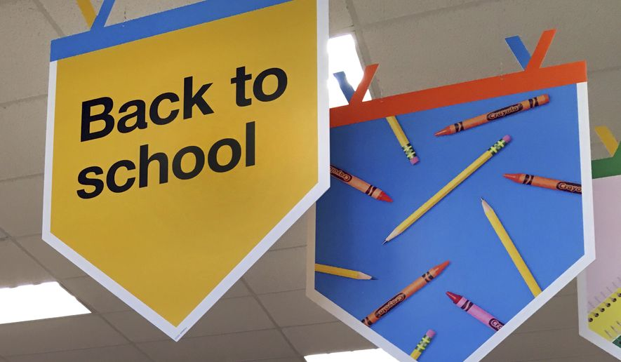 """In this July 31, 2018 photo, """"back to school"""" signage hangs in a store in Methuen, Mass. (AP Photo/Elise Amendola)"""