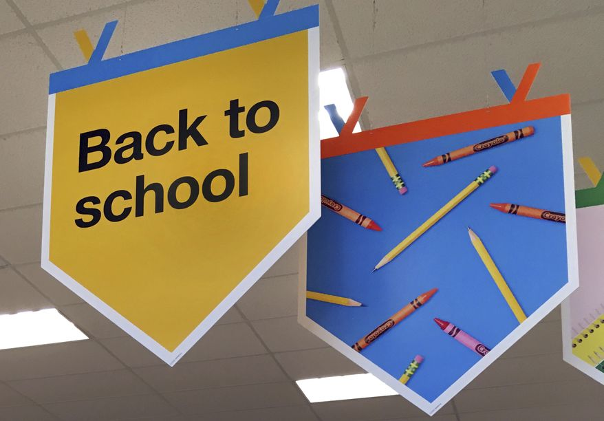 """In this July 31, 2018 photo, """"back to school"""" signage hangs in a store in Methuen, Mass. (AP Photo/Elise Amendola) *FILE**"""
