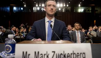 Facebook CEO Mark Zuckerberg arrives to testify before a joint hearing of the Commerce and Judiciary Committees on Capitol Hill in Washington about the use of Facebook data to target American voters in the 2016 election on April 10, 2018. (Associated Press) **FILE**