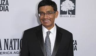 "Writer, executive producer and co-director Dinesh D'Souza arrives at the LA Premiere of ""Death of a Nation"" at the Regal Cinemas at L.A. Live on Tuesday, July 31, 2018, in Los Angeles. (Photo by Willy Sanjuan/Invision/AP)"