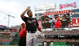 Washington Nationals' Ryan Zimmerman acknowledges the fans during the first inning of the team's baseball game against the New York Mets at Nationals Park, Tuesday, July 31, 2018, in Washington. It was announced that with Zimmerman's 1,695th hit, he set a franchise record. (AP Photo/Alex Brandon)