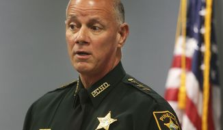 Pinellas County Sheriff Bob Gualtieri discusses the shooting of Markeis McGlockton during a press conference at the Pinellas County Sheriff's Administration Building in Largo, Fla., Tuesday, July 31, 2018. Gualtieri says the case of a white man who shot an unarmed black man, McGlockton, during a parking lot dispute is still under investigation and will be sent to the state attorney. (Dirk Shadd/Tampa Bay Times via AP)