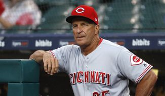 Cincinnati Reds interim manager Jim Riggleman watches from the dugout during the first inning of the team's baseball game against the Detroit Tigers in Detroit, Tuesday, July 31, 2018. (AP Photo/Paul Sancya) **FILE**