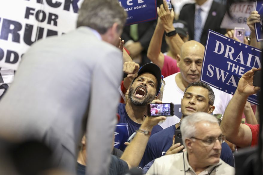Supporters of President Donald Trump yell at CNN reporter Jim Acosta Tuesday, July 31, 2018 at the State Fairgrounds in Tampa prior to an appearance by the President. (Chris Urso/The Tampa Bay Times via AP)
