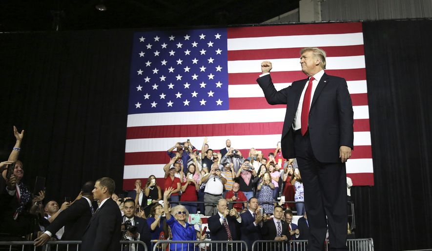 President Donald Trump attends a rally at the Florida State Fairgrounds Tuesday, July 31, 2018, in Tampa, Fla.(James Borchuck/Tampa Bay Times via AP)