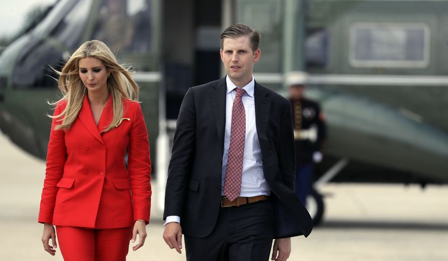 Ivanka Trump, the daughter of President Donald Trump, left walks Eric Trump, son of President Donald Trump, as they walk to  board Air Force One with President Donald Trump for a trip to Tampa, Fla., to attend a campaign rally, Tuesday, July 31, 2018, in Andrews Air Force Base, Md.  (AP Photo/Evan Vucci)