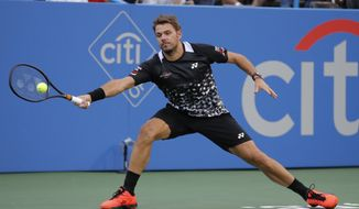 Stan Wawrinka of Switzerland returns against Donald Young during the first round of the Citi Open tennis tournament, Tuesday, July 31, 2018, in Washington. (AP Photo/Carolyn Kaster)