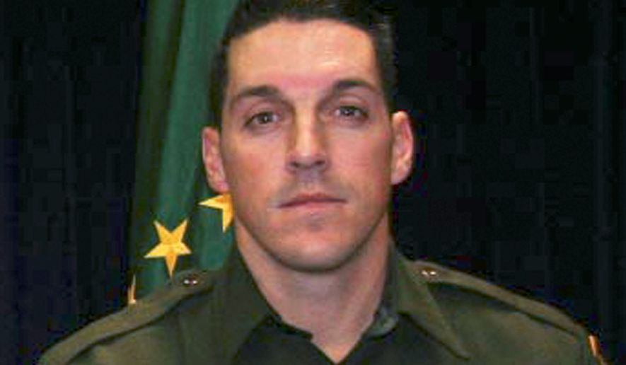 """This undated photo provided by U.S. Customs and Border Protection shows U.S. Border Patrol agent Brian A. Terry. Terry was killed in a 2010 firefight near the Arizona-Mexico border between U.S. agents and five men who had sneaked into the country to rob marijuana smugglers. On Monday Nov. 18, 2013 a judge dismissed federal employees from a wrongful death lawsuit filed by the family of the slain Border Patrol agent over the botched """"Fast and Furious"""" gun operation. (AP Photo/U.S. Customs and Border Protection, File)"""