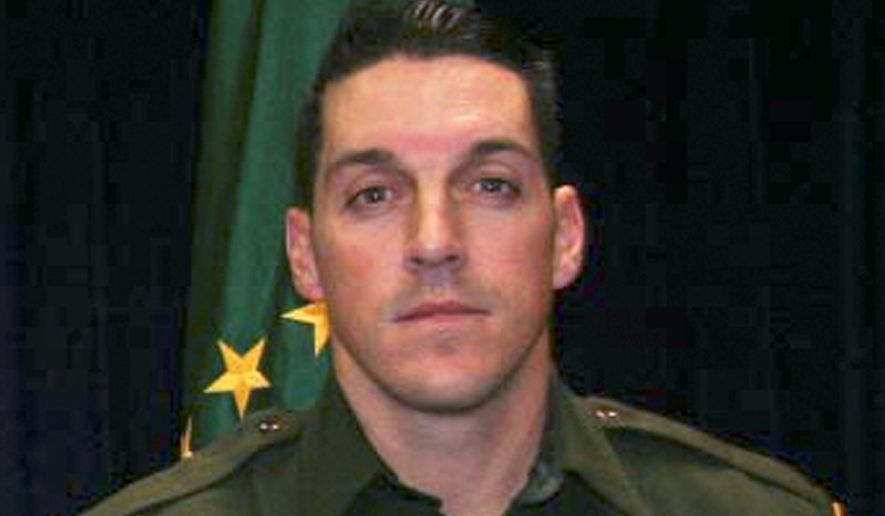 "This undated photo provided by U.S. Customs and Border Protection shows U.S. Border Patrol agent Brian A. Terry. Terry was killed in a 2010 firefight near the Arizona-Mexico border between U.S. agents and five men who had sneaked into the country to rob marijuana smugglers. On Monday Nov. 18, 2013 a judge dismissed federal employees from a wrongful death lawsuit filed by the family of the slain Border Patrol agent over the botched ""Fast and Furious"" gun operation. (AP Photo/U.S. Customs and Border Protection, File)"