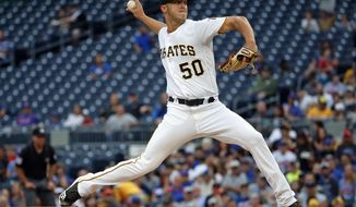 Pittsburgh Pirates starting pitcher Jameson Taillon delivers during the first inning of the team's baseball game against the Chicago Cubs in Pittsburgh, Tuesday, July 31, 2018. (AP Photo/Gene J. Puskar)