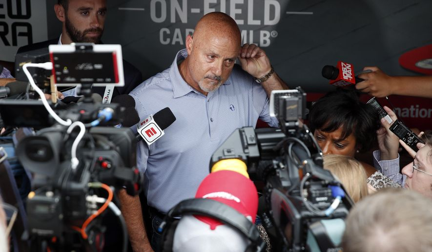 Washington Nationals general manager Mike Rizzo pauses while speaking during a media availability before a baseball game against the New York Mets at Nationals Park, Tuesday, July 31, 2018, in Washington. (AP Photo/Alex Brandon)