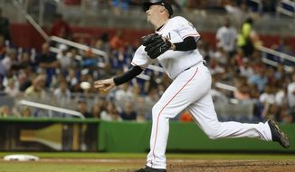 FILE - In this July 26, 2018, file photo, Miami Marlins' Brad Ziegler delivers a pitch during the sixth inning of a baseball game against the Washington Nationals, in Miami. Right-handed reliever Brad Ziegler has been traded to the Arizona Diamondbacks, who bolstered their bullpen for the pennant race and gave up Double-A reliever Tommy Eveld to the Florida Marlins, Tuesday, July 31, 2018. (AP Photo/Wilfredo Lee, File)