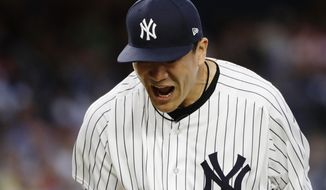 New York Yankees' Masahiro Tanaka, of Japan, reacts during the third inning of a baseball game against the Baltimore Orioles, Tuesday, July 31, 2018, in New York. (AP Photo/Frank Franklin II)