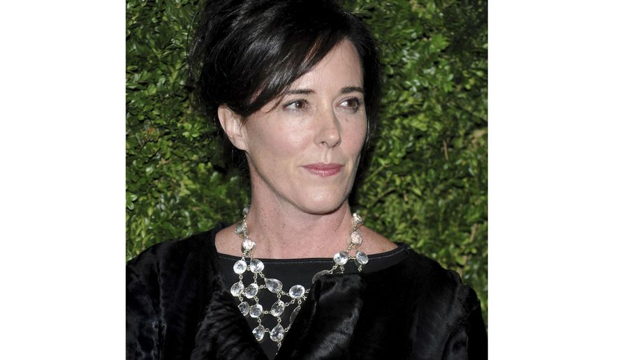 """FILE - In this Nov. 17, 2008 file photo, designer Kate Spade attends the CFDA/Vogue Fashion Fund finalists event in New York. Andy Spade, the widower of Kate Spade, has returned to Instagram with a heartfelt dedication to the late fashion designer nearly two months after her death. He posted a photo late Monday, July 30, 2018, of a desert tree he and their 13-year-old daughter Bea decorated with Christmas lights and a tin foil star made out of cardboard, writing it was """"like we do every Christmas."""" (AP Photo/Evan Agostini, File)"""