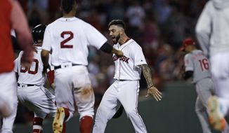 Boston Red Sox's Blake Swihart, right, is congratulated after his walk-off RBI double off Philadelphia Phillies relief pitcher Luis Garcia during the 13th inning of a baseball game at Fenway Park in Boston, Monday, July 30, 2018. The Red Sox defeated the Phillies 2-1. (AP Photo/Charles Krupa)