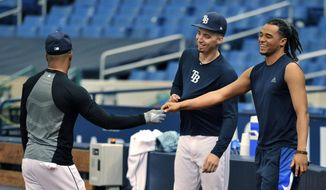 Tampa Bay Rays' Chris Archer, right talks with Mallex Smith, left, and Blake Snell, center, in the bullpen after he was traded to the Pittsburgh Pirates Tuesday, July 31, 2018, in St. Petersburg, Fla. The Pirates bolstered the front end of their rotation at the non-waiver deadline, adding Archer while sending the Rays a couple of coveted prospects in outfielder Austin Meadows and pitcher Tyler Glasnow and a player to be named. (AP Photo/Steve Nesius)